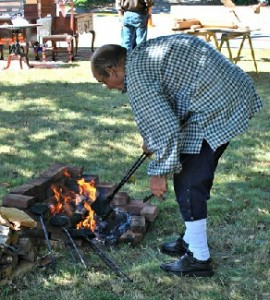 Waffle and wafer making over an open fire by Bill Kivic