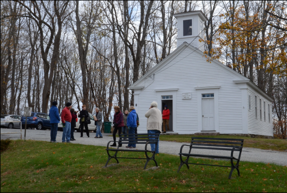 Visitors leaving the historic one-room Green district schoolhouse to begin the narrated walk